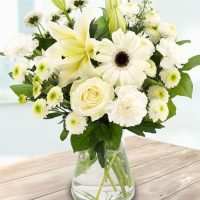 pure white Roses, Lilies, Gerberas, Asters, Carnations and Spray Chrysanthemums